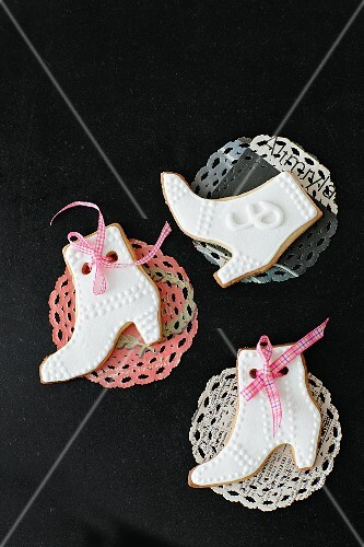 Boot-shaped biscuits on doilies
