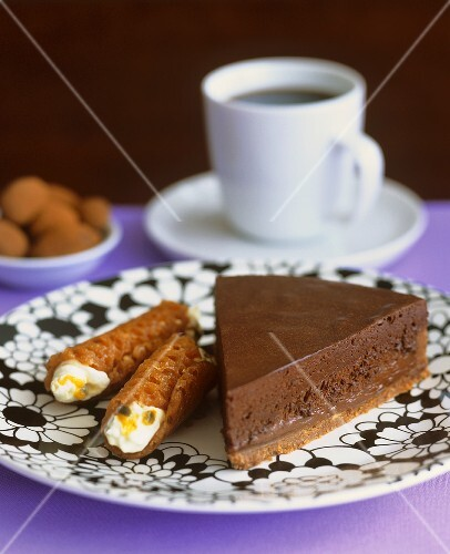 Piece of chocolate tart and brandy snaps with passion fruit filling