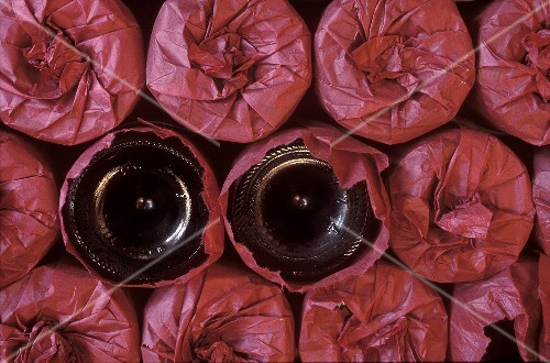 Wine Glasses Wrapped in Red Tissue Paper; Two Unwrapped