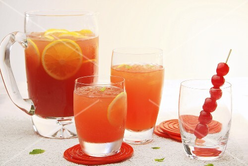 Fruit punch in glasses and a glass jug