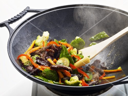 Stir-fried vegetables with beef being prepared