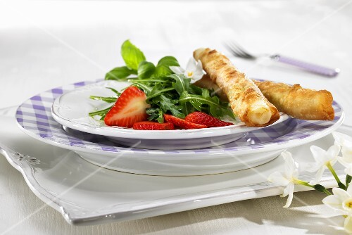 Asparagus wrapped in puff pastry with raspberries and rocket