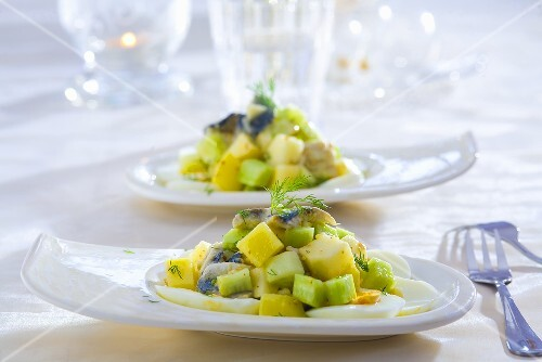 Herring salad with eggs, gherkins and potatoes
