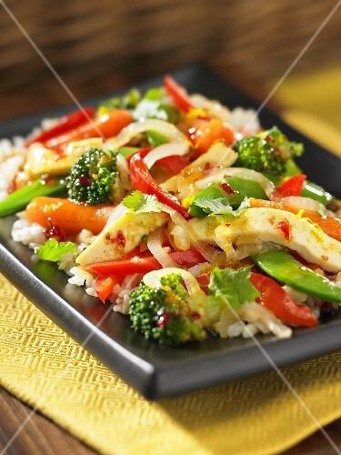 Stir-fried vegetables with tofu on a bed of rice