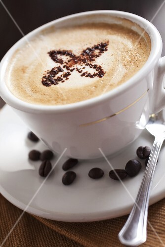 Cappuccino and coffee beans