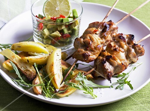 Chicken kebabs with avocado salsa, potatoes and rocket