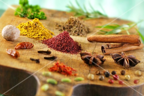 Various spices on a wooden board