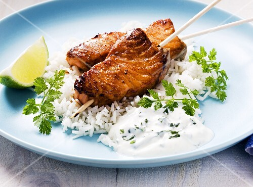 Salmon kebab with honey and lime on a bed of rice