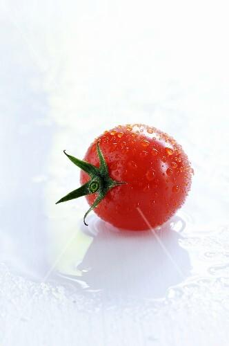 A freshly washed cherry tomato