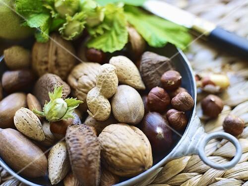 Various nuts in a metal bowl