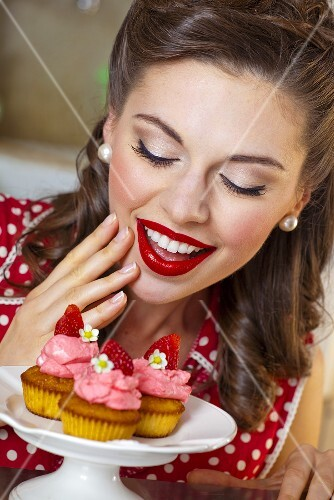 A retro-style girl with strawberry muffins