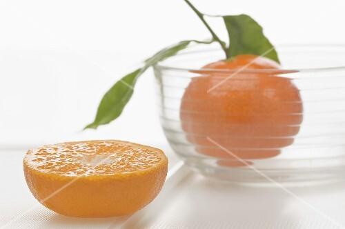A mandarin slice and a whole mandarin