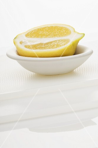 Half a lemon in a bowl