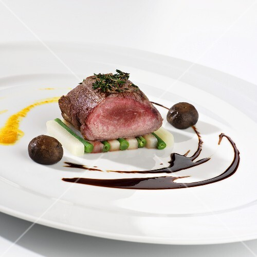 Saddle of venison on a bed of vegetables
