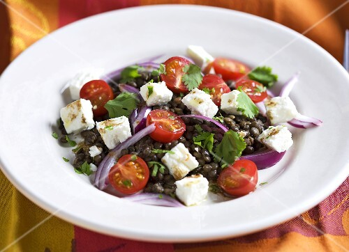 Lentil salad with sheep's cheese, tomatoes and onions