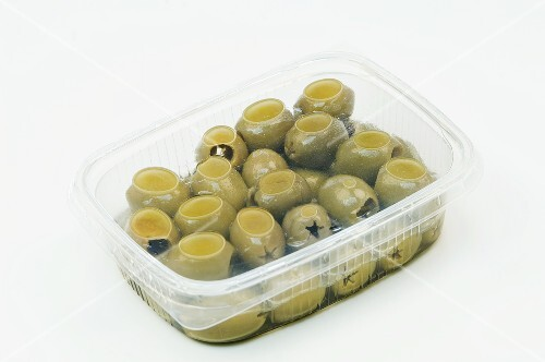 Green olives in a plastic container
