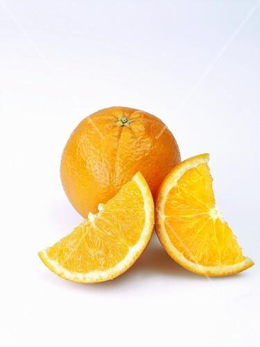 A whole orange and orange slices