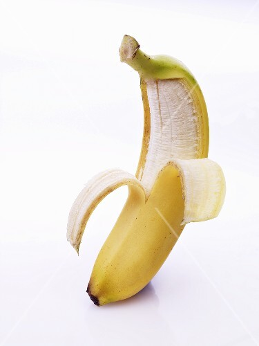A banana, half peeled