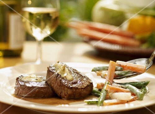 Beef steaks with carrots and beans