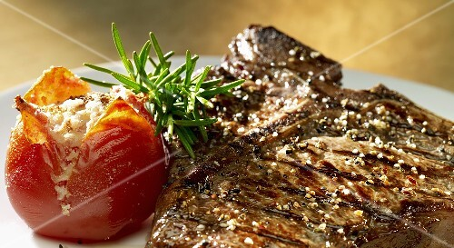 Grilled T-bone steak with tomatoes and rosemary