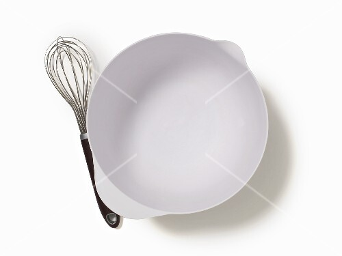 An Empty Mixing Bowl and a Whisk; From Above; White Background