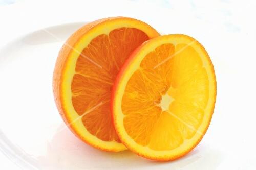 Half an orange and and orange slice