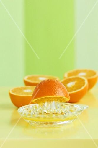 Orange halves with a juicer