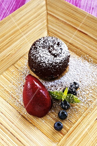 Warm chocolate cake with berry sorbet