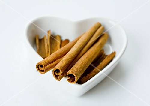 Cinnamon stick in a heart-shaped bowl