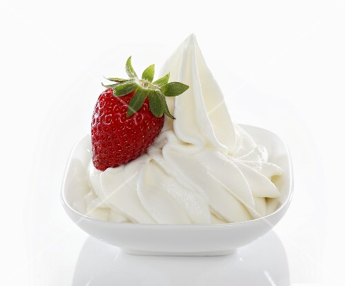 Yogurt ice cream, garnished with fresh strawberries