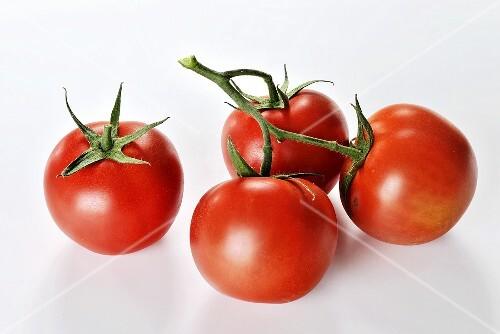 Four Vine Ripe Tomatoes on White