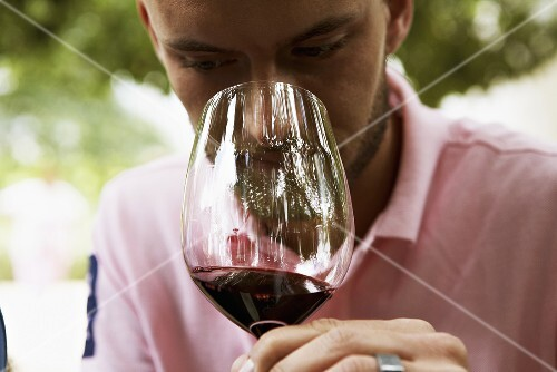 A man tasting wine