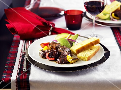 Slice sirloin steak with avocado and bread for Christmas