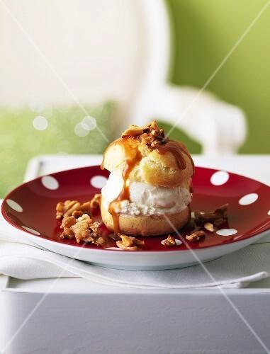 Cream puff with ice cream and caramel sauce