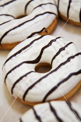 Iced donuts with chocolate stripes