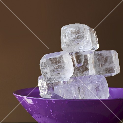 Ice cubes in a lavender colored dish