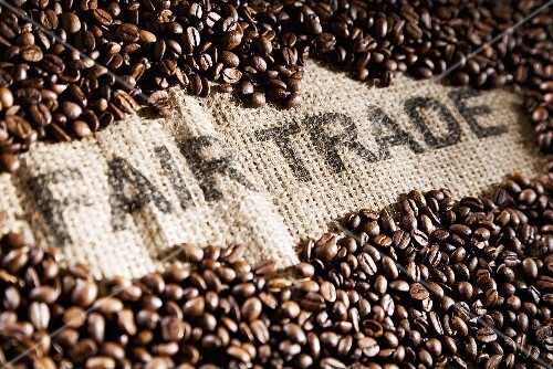 Coffee beans on a jute sack with writing