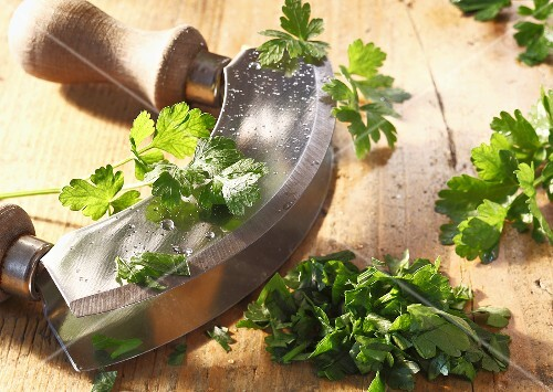 Fresh parsley with a chopping knife