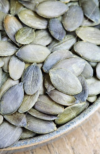 A bowl of pumpkin seeds (detail)