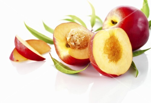 Nectarines, whole, halved and slices