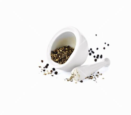 Black peppercorns in a mortar
