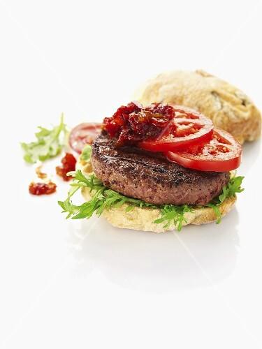 Pork hamburger with tomatoes
