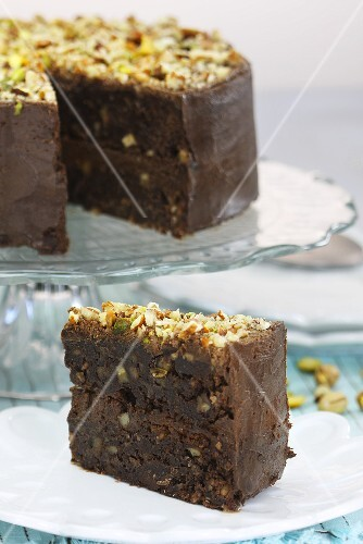 Chocolate brownie cake with nuts and pistachios, sliced