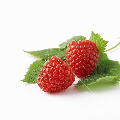 Two raspberries with leaves