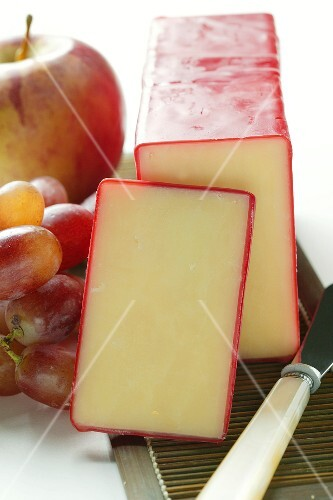 Classic Vermont Cheddar with cheese knife and fruit