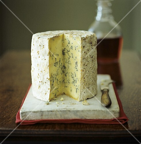 Stilton cheese with knife and port wine