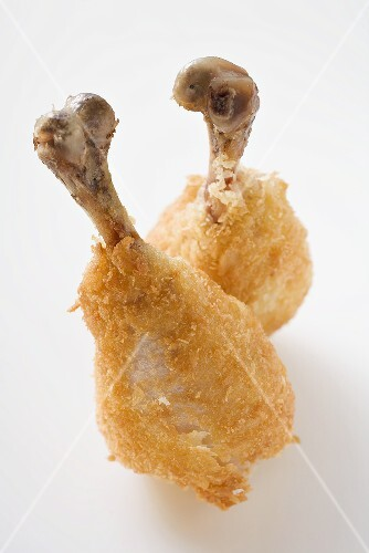 Two breaded chicken legs