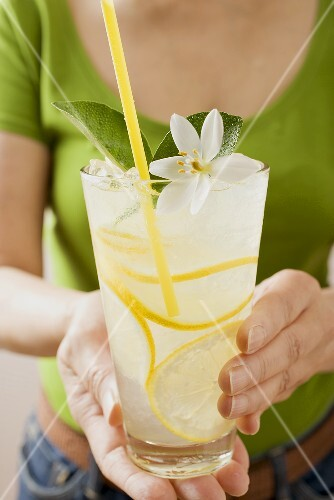 Woman holding a glass of lemonade
