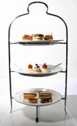 Savouries and cakes for afternoon tea on tiered stand