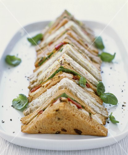 Assorted sandwiches (tramezzini) in a row